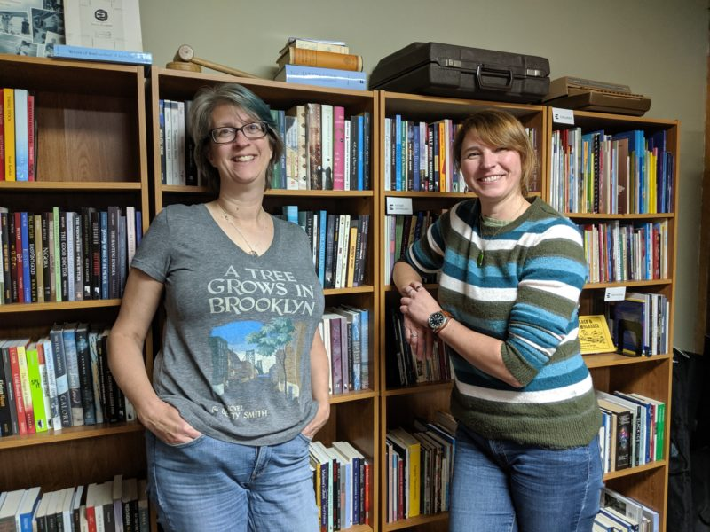 Trudy Morgan-Cole and Kelley Power conspire between the bookshelves at WANL